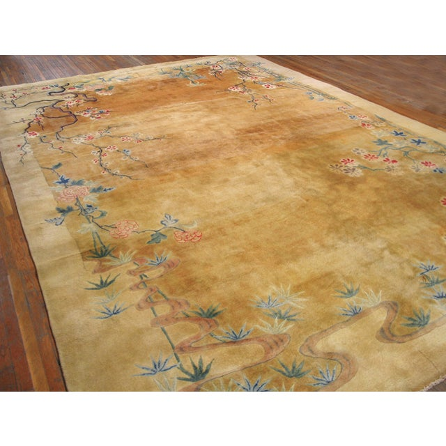 Antique Chinese Art Deco Rug with a beige background.