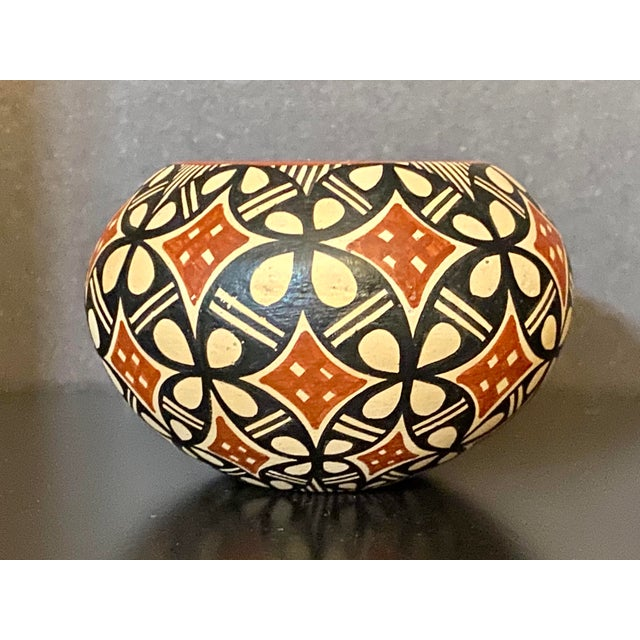 Gorgeous piece of pottery from Jemez Pottery. Excellent pattern. Some wear and marks.