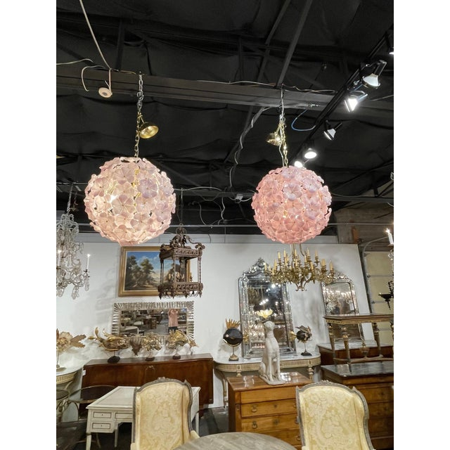 Magnificent modern Murano glass pink flower globe chandeliers. Beautiful flowers in a lovely shade that create a huge...