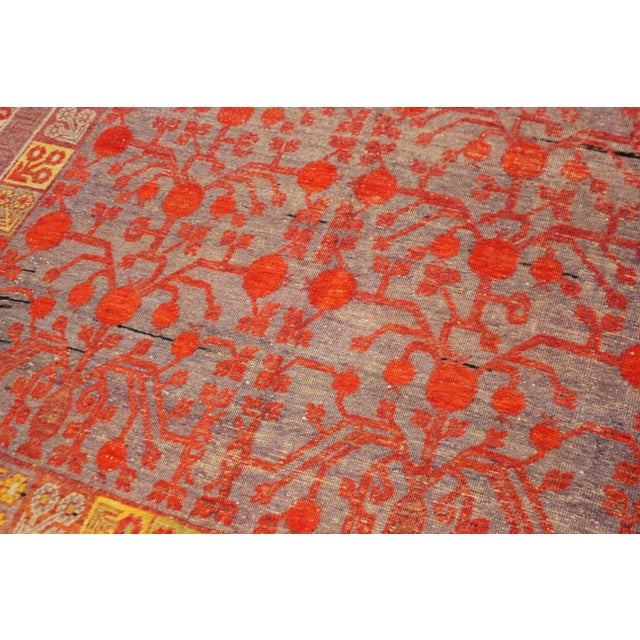 This stunning antique Khutan rug was hand knotted in 1880's in China. Knotted with 75% wool and 25% cotton, dyed with...