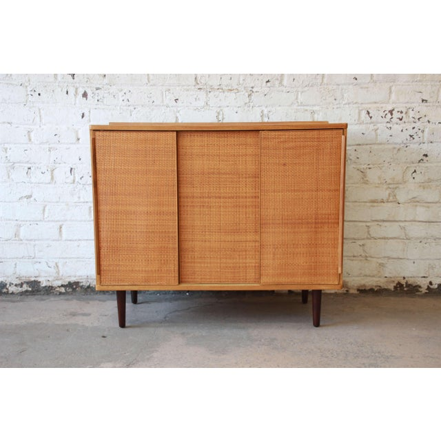 A beautifully restored woven front cabinet/drsser by Edward Wormley for Dunbar. This cabinet is one of Wormley's early...