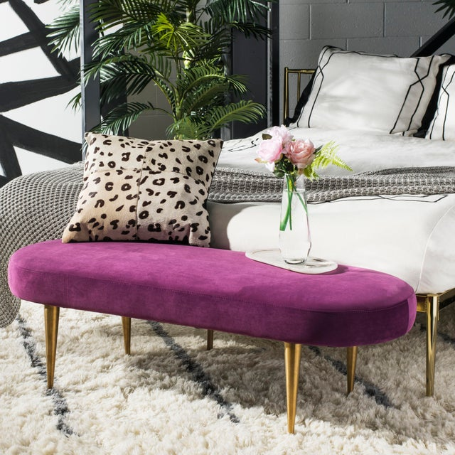 Add a touch of glamour to any modern décor with this plum velvet oval bench. it's retro gold legs and chic curves add the...