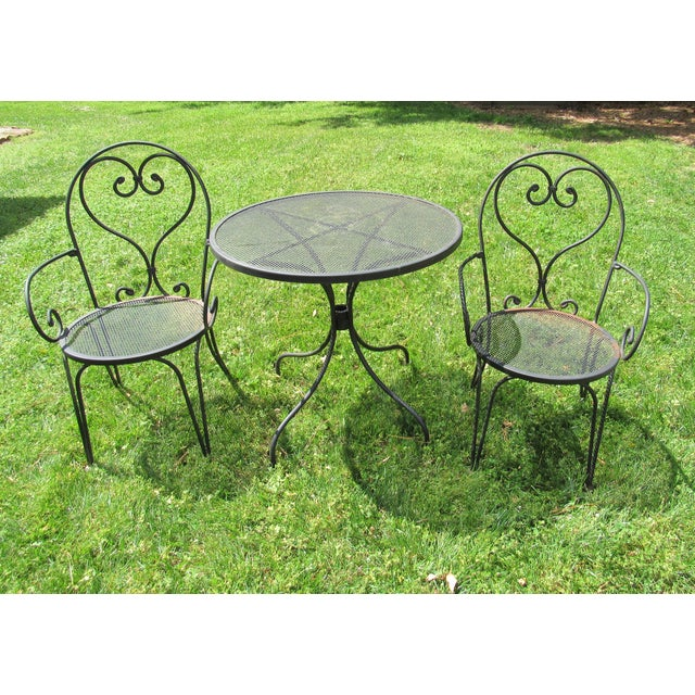 Vintage wrought iron Parisian style cafe bistro set with wire mesh table top and seats. Very well made, very sturdy, and...