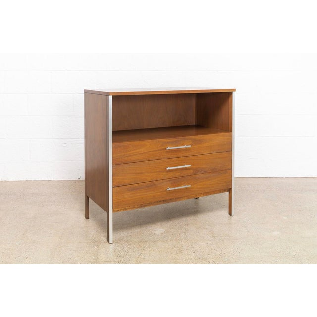 This vintage mid century modern Paul McCobb walnut chest of drawers was produced by Calvin Furniture circa 1950 as part of...