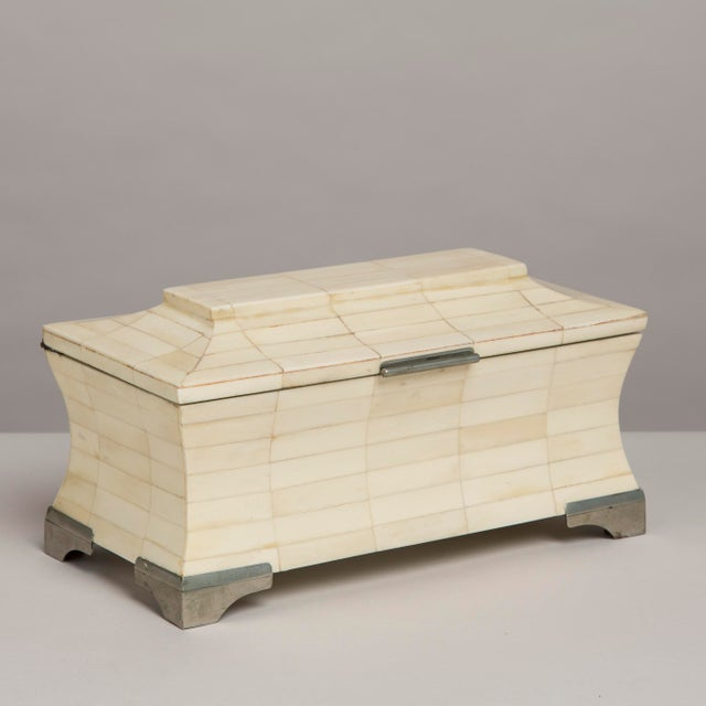 A Tessellated Bone Veneered Hinged Lidded Box with Silvered Metalwork Detail 1970s. NB: These items are subject to a...
