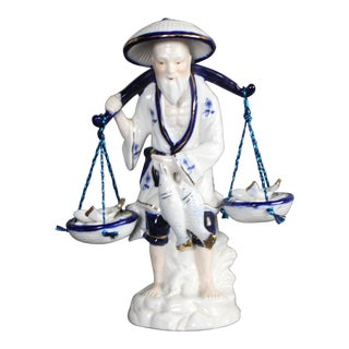 1970's Chinoiserie Chinese Fisherman Carrying Baskets of Fish Blue and White Porcelain Figurine For Sale