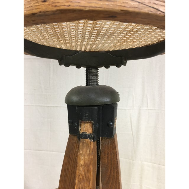 Antique industrial Bentwood adjustable oak swivel stool. The stool can be approx 29 to 35 inches high. The foot rest is 16...
