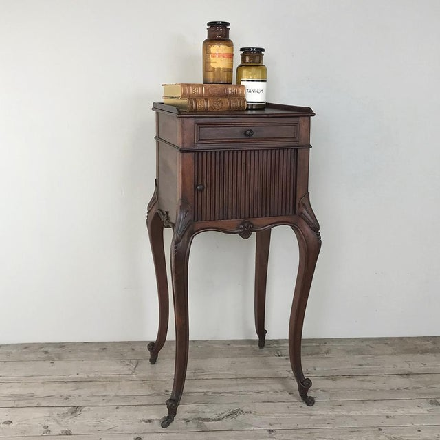 Antique Country French Nightstand was hand-crafted from solid French walnut, and features a rail around the top, a...