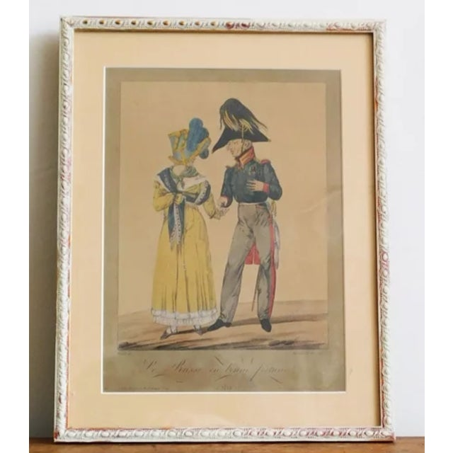 Antique 1814 print of Napolean style man and woman. Comes in a white-washed painted frame and ready to hang.