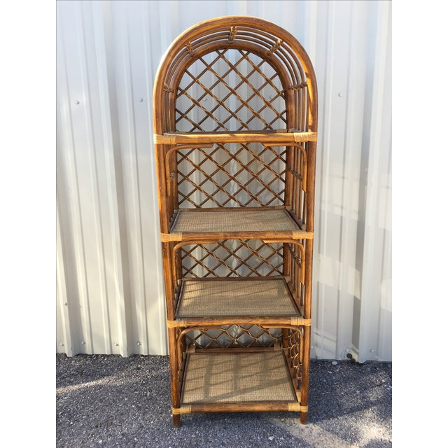 Nice rattan shelf unit in good condition, some loose wicker strapping. Removable shelves. Light touch up needed as it...