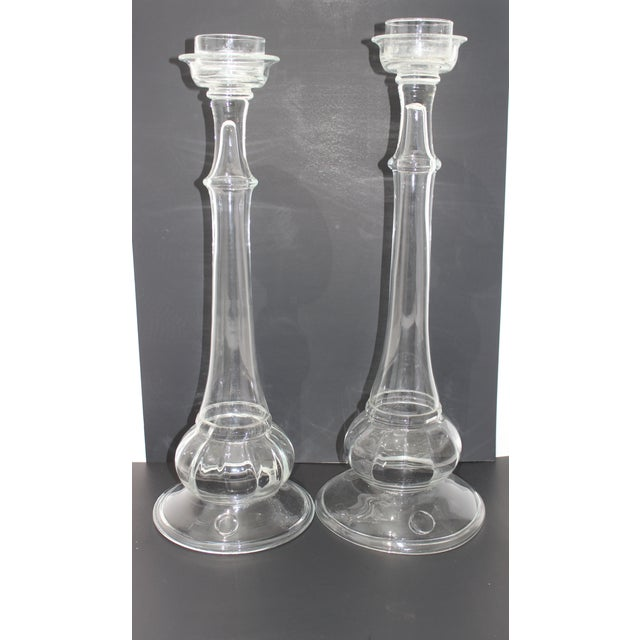 This stylish set of two handblown glass candle sticks date to the 1970s-1980s and were created by Blenko Glass. Note:...