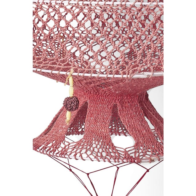 Handmade decorative lanterns from Varanasi India. Macrame type knotting and interwoven yarns. Woven on metal frames.