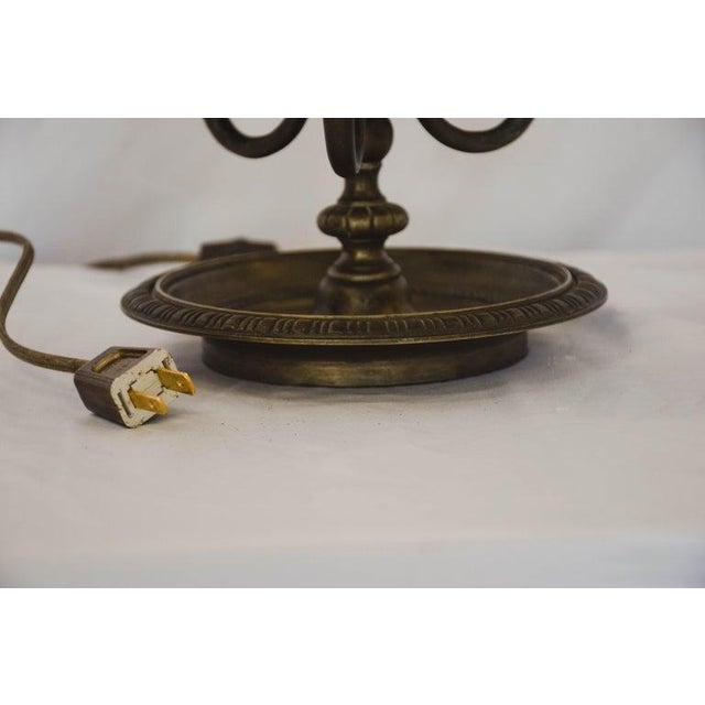 French Bouilotte lamp. Newly wired to US standards. Black shade with gold lining. Gold leaf detail on the exterior of the...