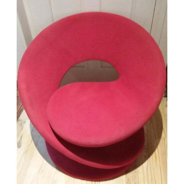 Beautiful red spiral chair is a work of art! It's an odd color red with a pinkish tone. Design created by Louis Durot in...
