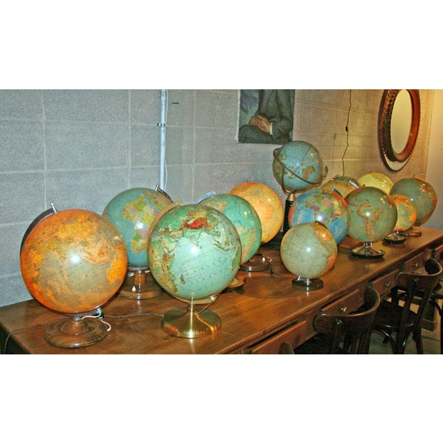 A series of gorgeous glass globes on original vintage bases ranging from 1915 to the 50s! Light up your library! SOLD...