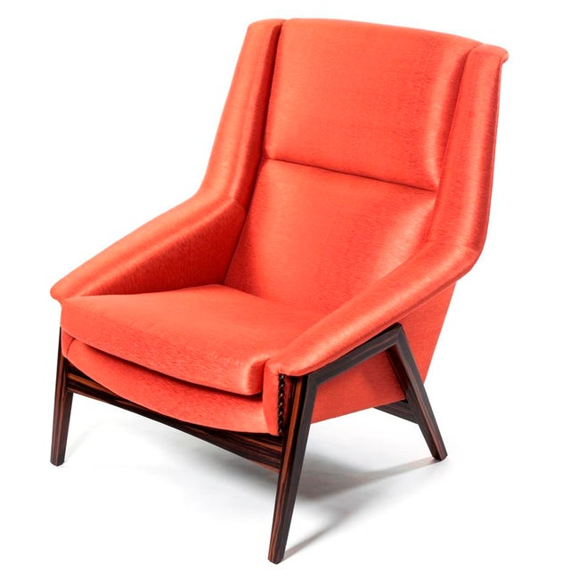 Beautiful silk upholstered armchair in orange with wooden frame. This chair was displayed in our showroom for some time...
