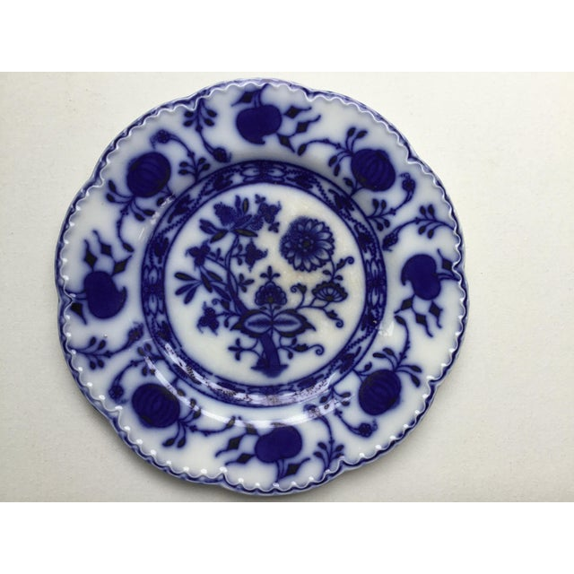 """Pair of beautiful and delicate antique plates . 8""""' and 6.3"""" in diameter . Pattern very similar to a """" blue onion"""""""
