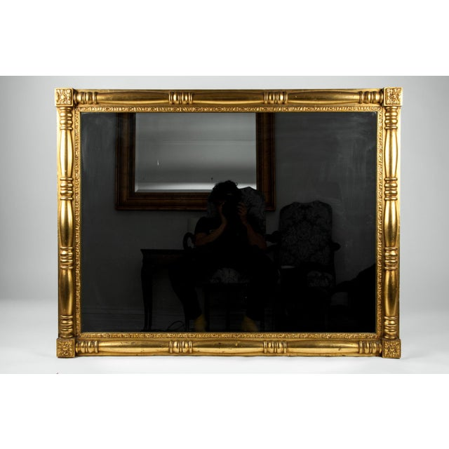 Vintage European gilded wood framed mantel or fireplace hanging wall mirror. The mirror is in excellent vintage condition...
