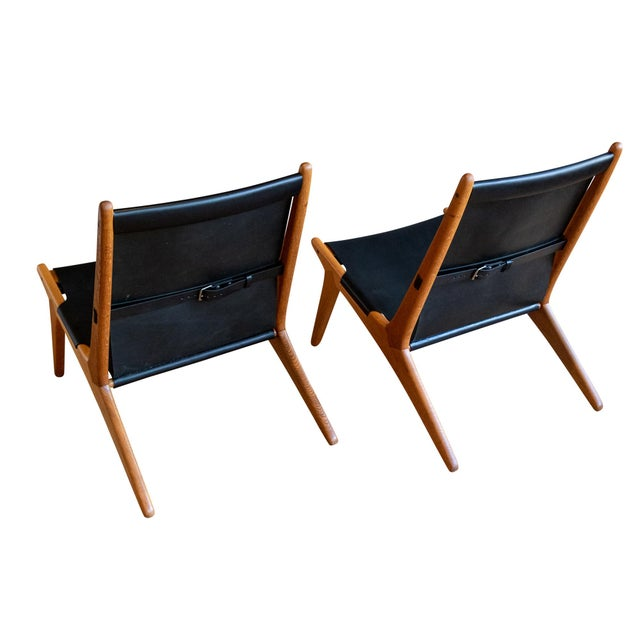 A striking pair of Model 204 or Hunting Chairs for Luxus by Swedish designers Uno & Östen Kristiansson, ca. 1954....