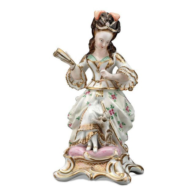 A wonderful old Paris porcelain veilleuse of a marquise with a dog. These wonderful porcelain wares were once used for...