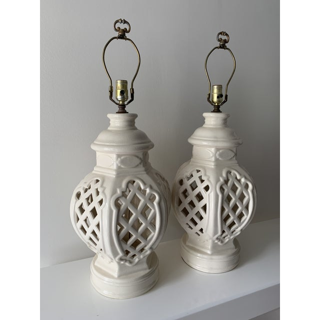 Stunning, vintage ginger jar lamps. Perfect cream color on crackled porcelain finish. Intricate cutouts give this piece a...