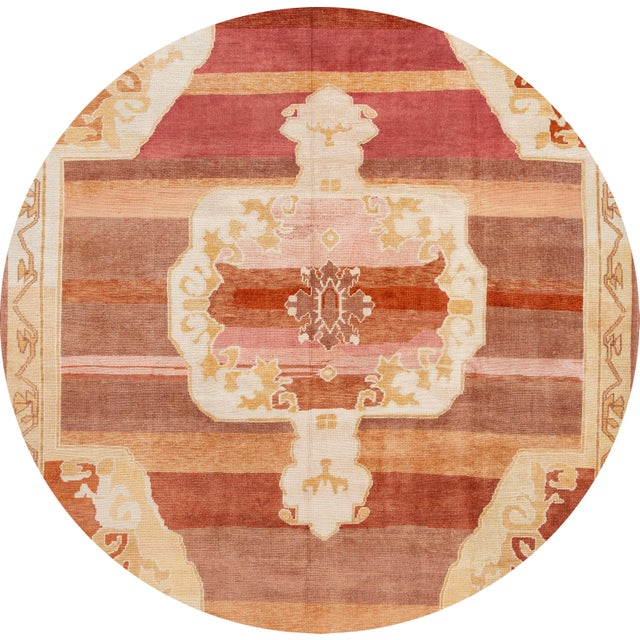 Beautiful Modern Kars Hand-knotted Wool rug with a brownfield, and frame of tan. This rug has multi-color accents in...