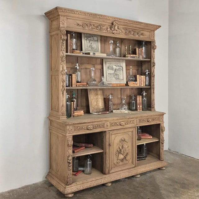 19th Century French Renaissance Stripped Oak Bookcase is a marvel of visual magnificence, with a boldly carved and molded...