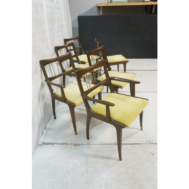 A great set of set 6 walnut dining chairs by Lane, circa 1960. These Mid-Century Modern dining chairs consist of 2...