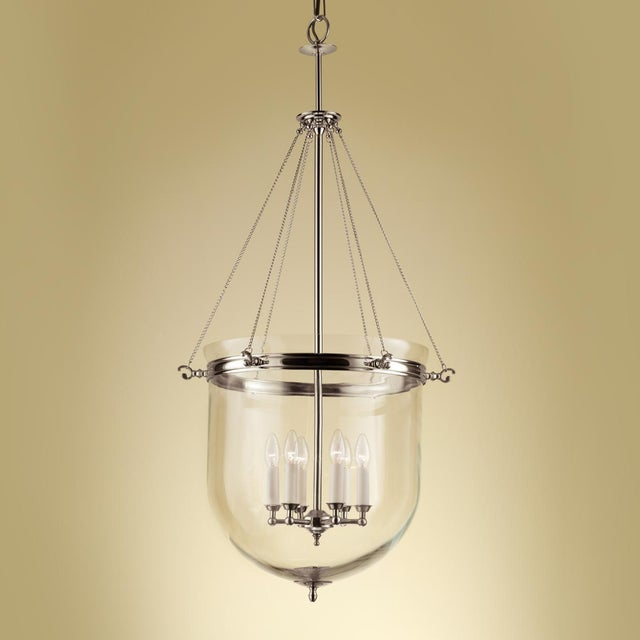 "Polished nickel lantern with glass and 6 candle lights. Width: 56cm / 22"" Depth: 56cm / 22"" Height: 143cm / 56.3"" Weight:..."