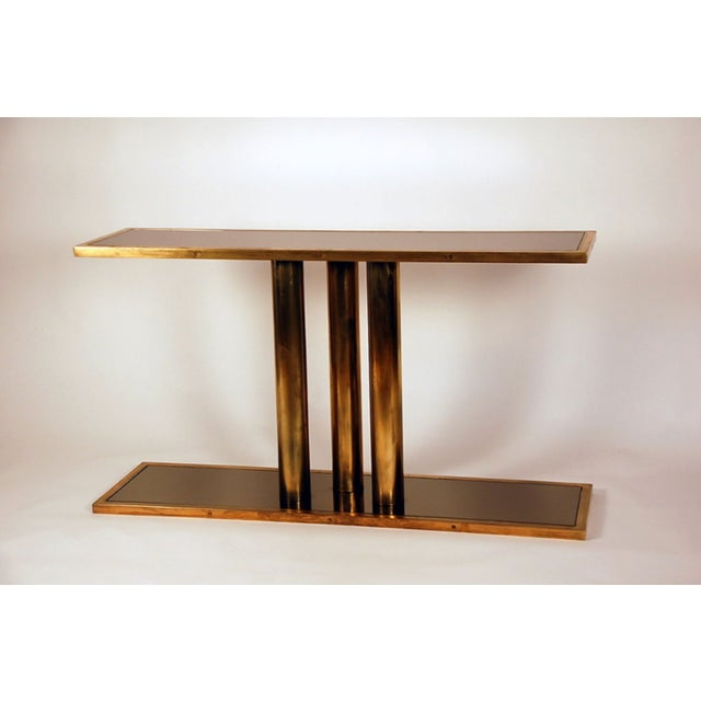 """The """"Calandre"""" Brass and Bronze Mirrored Console."""