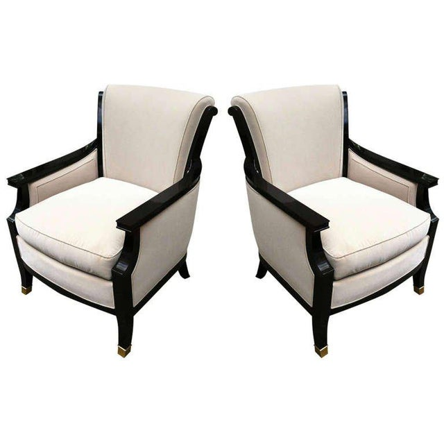 MaisonJansen Pair of chicest 1940s chairs black lacquered with gold bronze sabot.