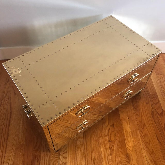 Bad ass brass trunk! Made in Spain by Sarreid Ltd, this shiny brass clad 2-drawer trunk/coffee table is a stunner. The...