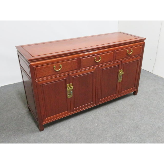 Chinese rosewood Sideboard, 3 drawers over 4 doors, 3 fitted drawers inside right pair of doors, brass hardware with...
