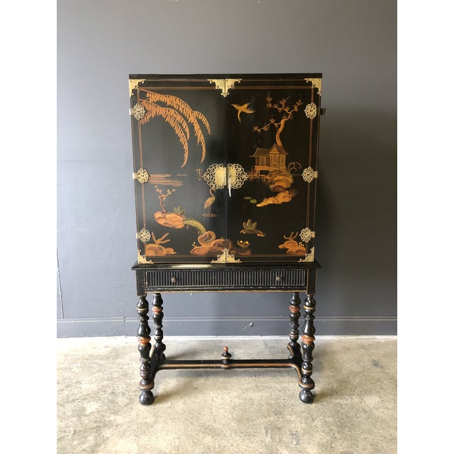 1920's black lacquer Chinese cabinet. Gorgeous detail, original brass hardware, excellent vintage condition.
