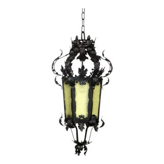 Restored 19th Century Black Wrought Iron Lantern With Textured Amber Glass For Sale
