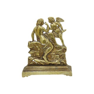 Antique English Brass Cupid Doorstop For Sale