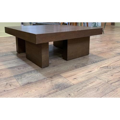 We love the different and unusual and this piece has it. A square wood mid century coffee table but look at its base!...