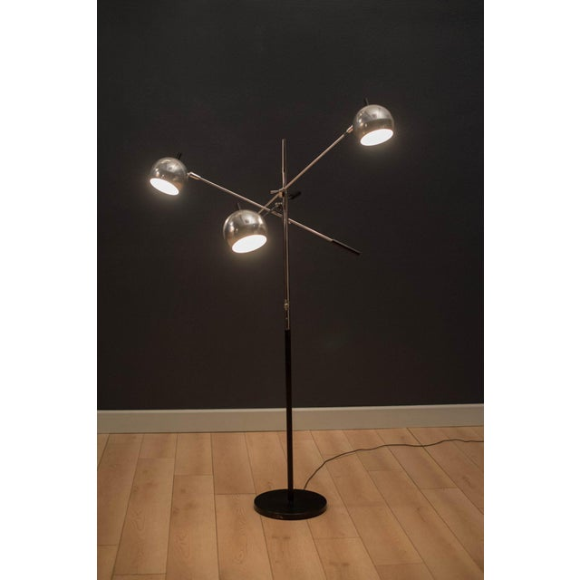 Mid-century modern triennale floor lamp designed by Robert Sonneman. This versatile piece features three adjustable chrome...