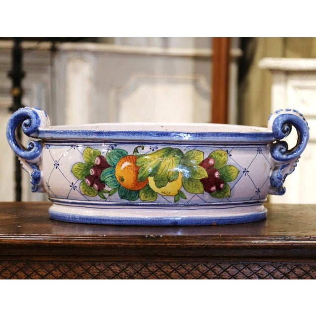 Decorate a buffet or dining table with this colorful cache pot. Hand crafted in France circa 1980 and oval in shape, the...