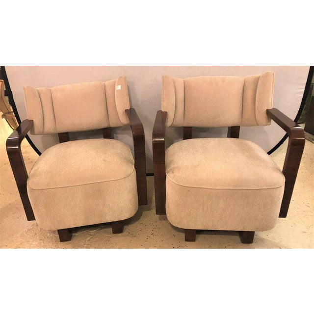 Pair of Modern Art Deco rosewood club chairs. Each having been finely hand rubbed French polished. Each with a rosewood...