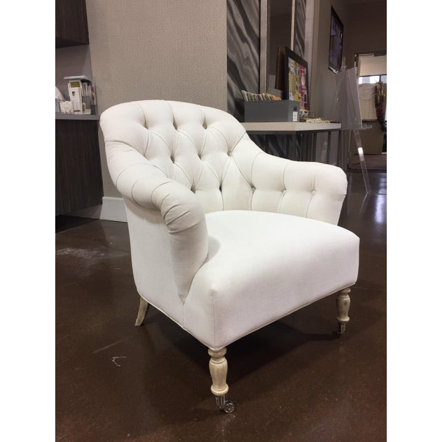 Troy MI floor sample Clarendon arm chair Tight seat Tufted back Caster on front leg