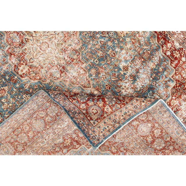 A hand-knotted antique Persian rug with a medallion design. This piece has great detailing and colors. It would be the...