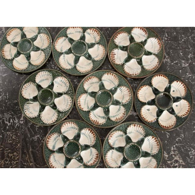 A fantastic set of eight Barbotine Longchamp Terre de Fer oyster plates from France. Each plate has six styled scallop...