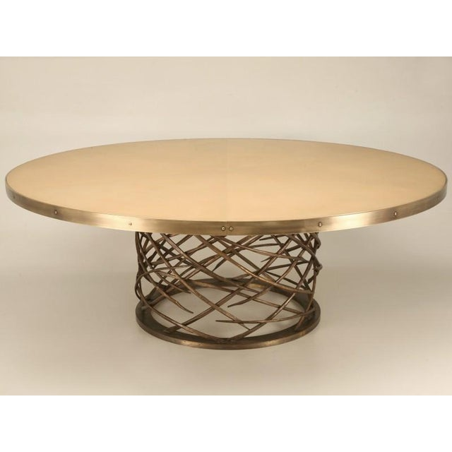Old Plank custom-made solid bronze table base with intricate woven pattern. This table is an example of outstanding...
