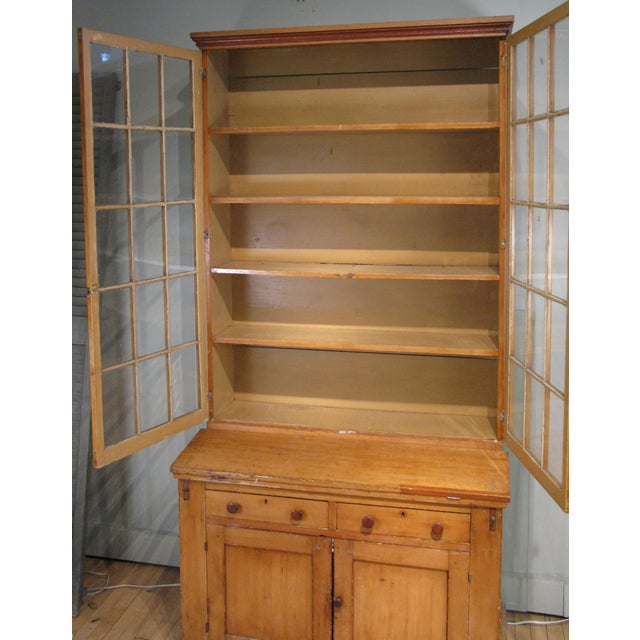A very handsome antique late 19th century secretary bookcase with a fold out desk surface. Upper section has a pair of...