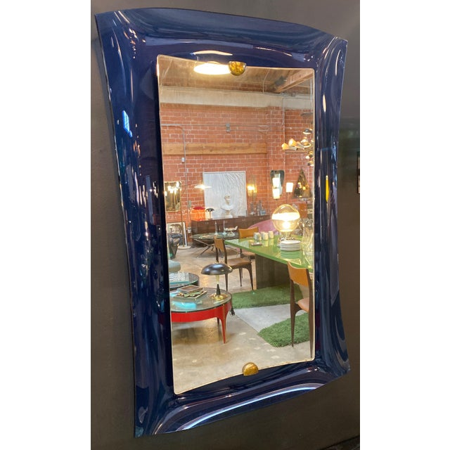 A rare mirror by Max Ingrand for Fontana Arte in blue colored glass, mirrored glass and brass. Back of the mirror has old...