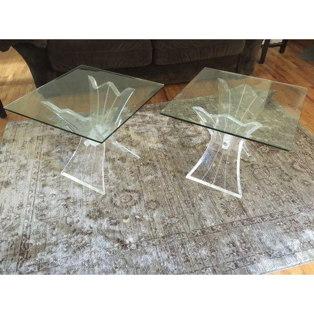 These gorgeous lucite and glass side tables feature butterfly bases and beveled glass. One missing lucite bolt cover up.