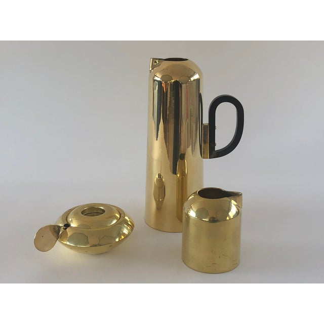 This beautiful brass tea set is made by Tom Dixon based on a British tea set. This has been previously owned but never used.