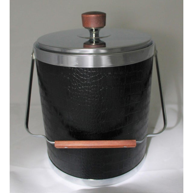 Handsome mid-century modern ice bucket by Kromex covered in black faux alligator or crocodile with chrome trim and lid;...