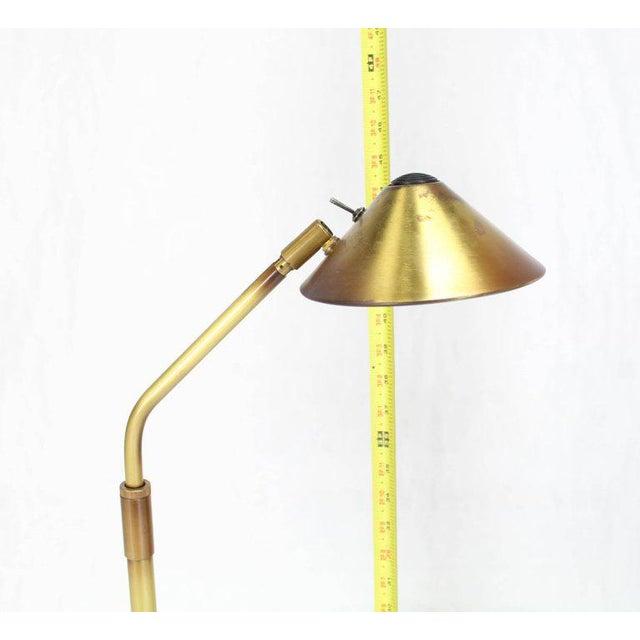 """Covacs adjustable Mid-Century Modern brass floor reading lamp. Measure: Adjustable height 45-62""""."""